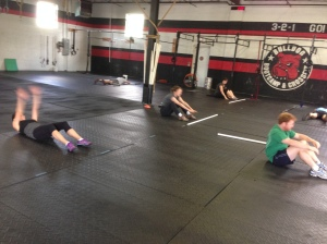 Kate, her good friend Alice, Emily (a friend and dedicated CrossFitter), and my brother-in-law do the WOD.